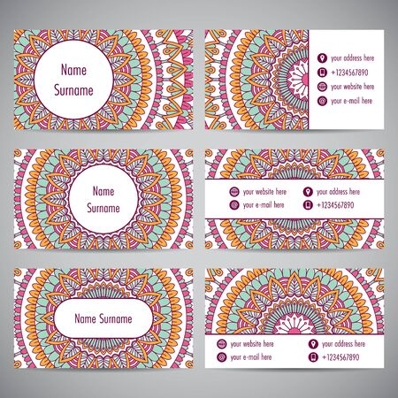 Set of business cards with floral mandala ornaments.