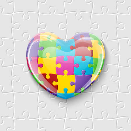 World autism awareness day. Colorful glass heart made of puzzle pieces.