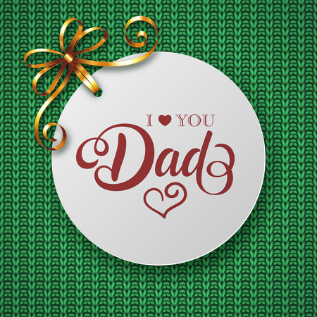 Fathers day greeting card with golden ribbon and handwritten message on knitted background