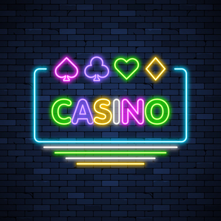 Casino glowing neon sign on brick wall background