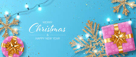 Christmas background with shiny snowflake made of golden confetti, gift boxes and lights garlands. Design element for greeting card, party invitation or banner
