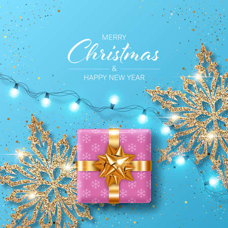 Christmas background with shiny snowflakes made of golden confetti, gift boxes and lights garlands. Design element for greeting card, party invitation or banner