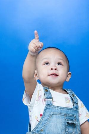 Child raises up forefinger in studio Stock Photo - 17259984