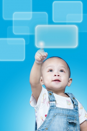 Child raises up forefinger is push button Stock Photo - 17641812