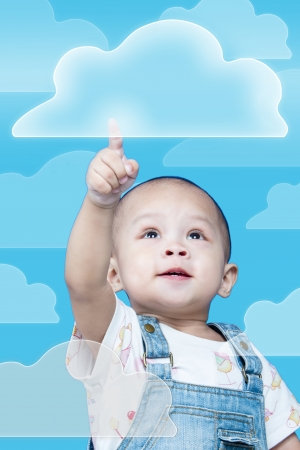 Child raises up forefinger is push button Stock Photo - 17641809