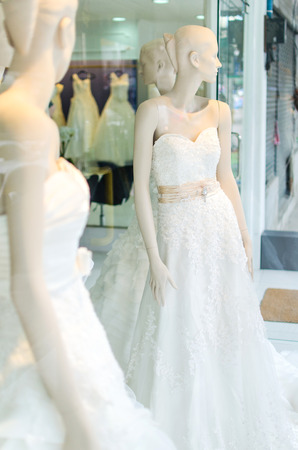 drycleaning: Wedding dress on pink tone Stock Photo