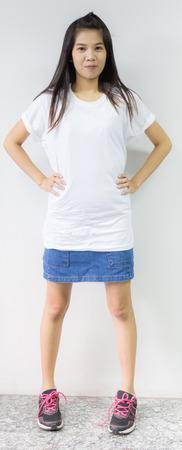 Portrait of young woman on white concrete wall Banco de Imagens