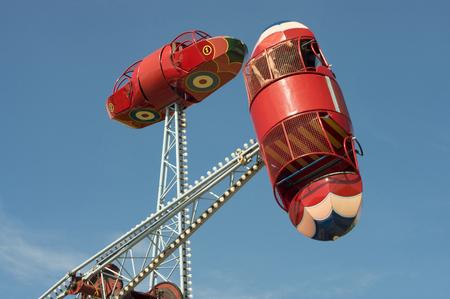 Vintage bomber swing diver at amusement park