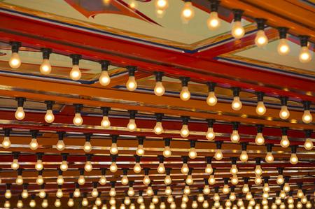 Light bulbs of a caroucel at vintage amusement park