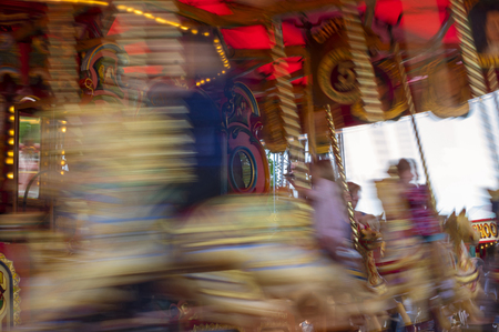 Vintage Carousel in gold and red blurred of motion Reklamní fotografie