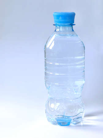 New plastic bottle full of clean drinking water with copy space Stock Photo