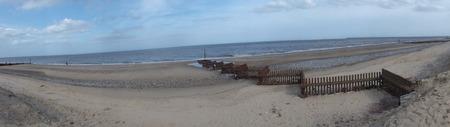 groyne: Panoramic of  a sandy Norfolk beach resort with groyne