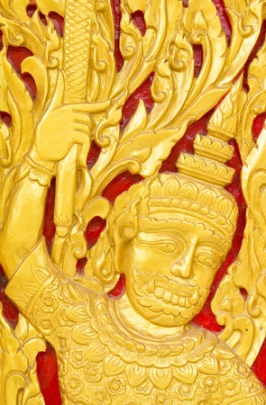 Traditional Thai art by wood carvings on a window in a temple  Wat Kham Thale So ,NAKORNRATCHASIMA,THAILAND photo