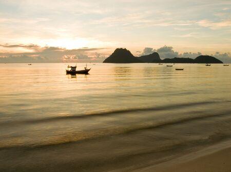 Fishing boat with Sunrise on the sea  Prachuap Khiri Khan,THAILAND photo