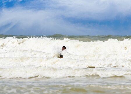 Sea attack people who are swimming in the sea  photo