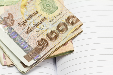 Thai money on the leather book   Stock Photo