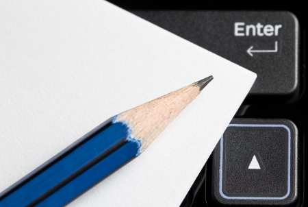 Note Paper with a pencil on a computer