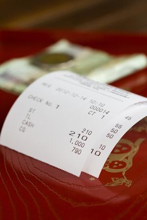 till: paper  bill on a till roll printout  Stock Photo