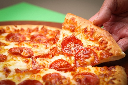 pepperoni pizza on wooden board Stock Photo