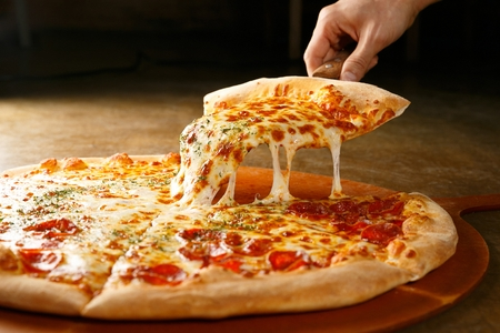 pepperoni pizza on wooden board Stockfoto