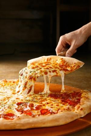 pepperoni pizza on wooden board Archivio Fotografico