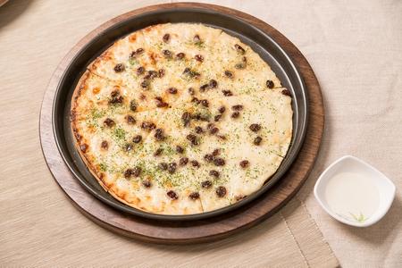 Gorgonzola pizza on table