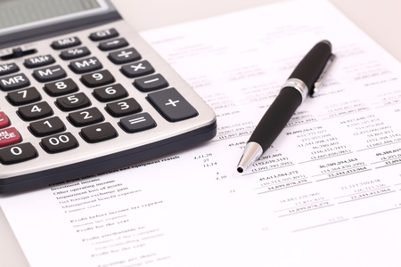 calculator and stationery items on the table Stock Photo