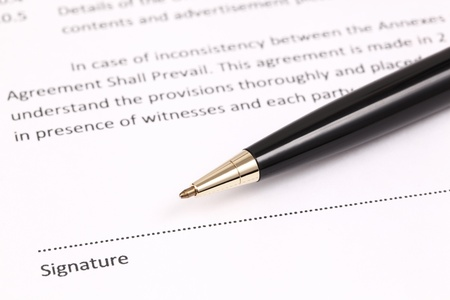 Close-up of gold pen on contract  isolated Stock Photo - 17894842