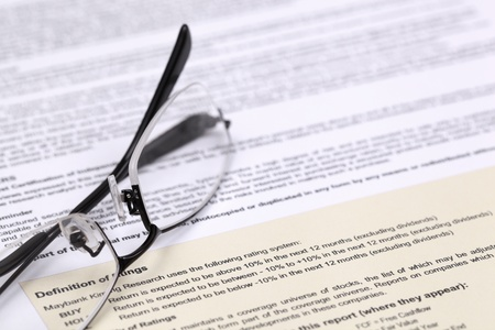 Eye glasses and document close up photo
