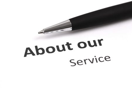 about our service with pen Stock Photo