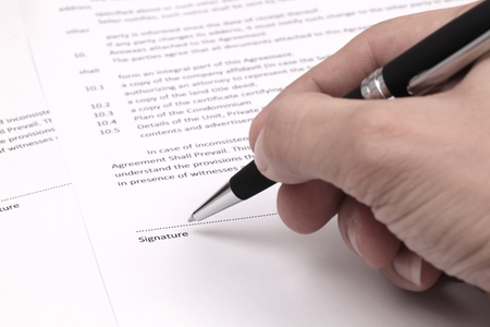 Close up of businessman signing a contract Stock Photo - 17998790