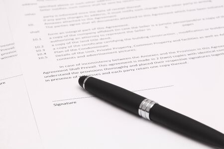 Close up of businessman signing a contract Stock Photo - 17998789