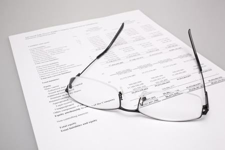 bifocals: Reading finance report with glasses