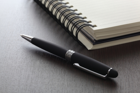 pen and notebook on the wood table Stock Photo - 18090520