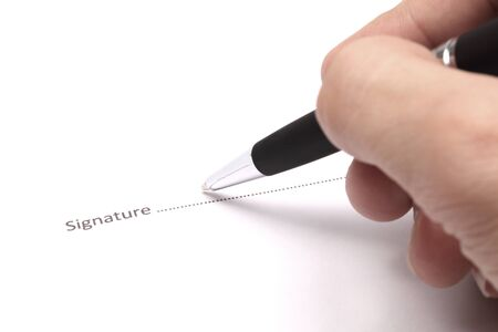 Close up of businessman signing a contract Stock Photo - 18133679