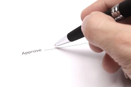 Close up of businessman signing a approve Stock Photo - 18133680
