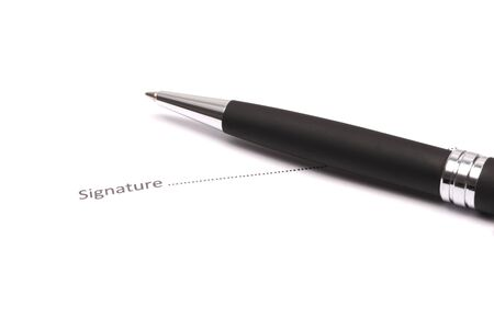 Close up of businessman signing a contract Stock Photo - 18133677