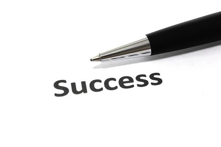 Success with pen isolated close-up photo