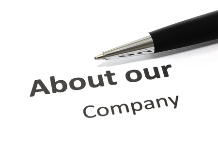 about us: About our company with pen isolated Stock Photo