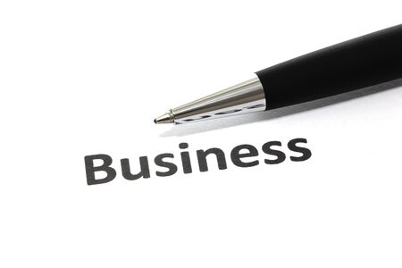 Business with pen isolated close-up photo