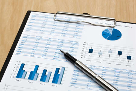 Financial paper charts and graphs photo