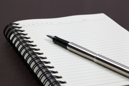 Blank note paper with pen Stock Photo - 18357240
