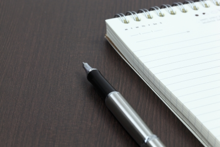 Blank note paper with pen Stock Photo - 18357245