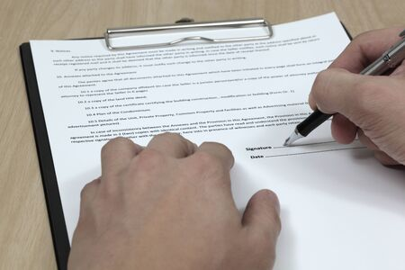 Business man signing a contract Stock Photo - 18379881
