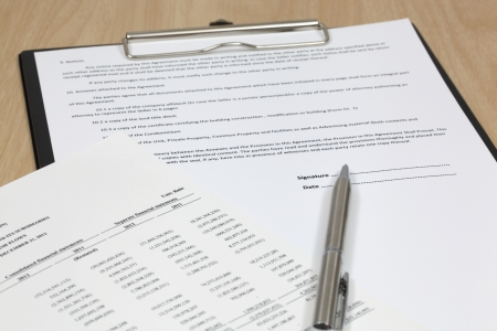 Close up of signing a contract Stock Photo - 18379835