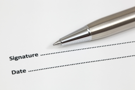 Close up of signing a contract Stock Photo - 18379837