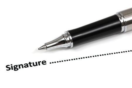 Close up of signing a contract Stock Photo - 18379791