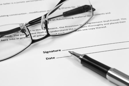 Close up of signing a contract Stock Photo