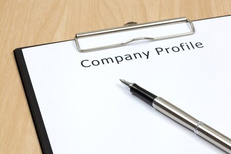 The word company close up in paper Stock Photo - 18413870