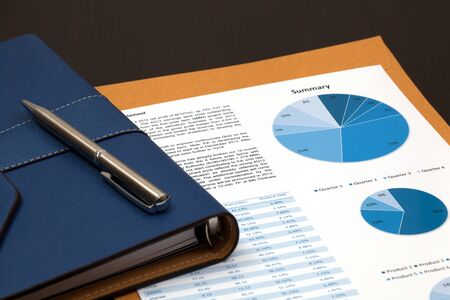 Financial graphs analysis on table photo